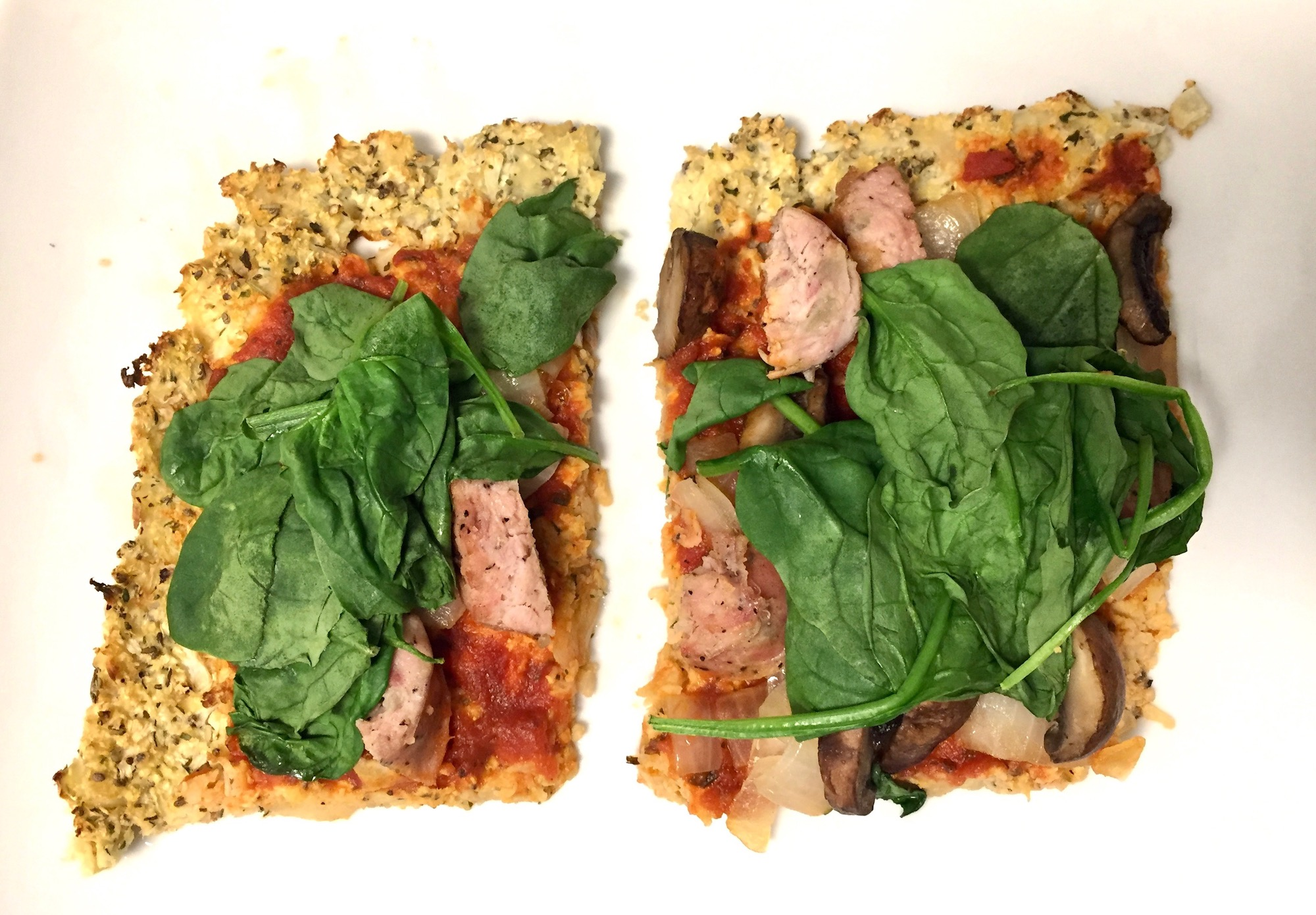 Paleo Cauliflower Pizza With Sausage And Spinach